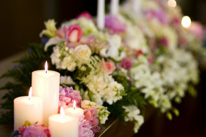 beautiful flowers among lit candles